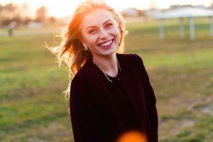 lady smiling during sun set