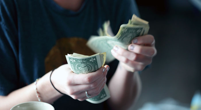 a girlfriend is counting the money