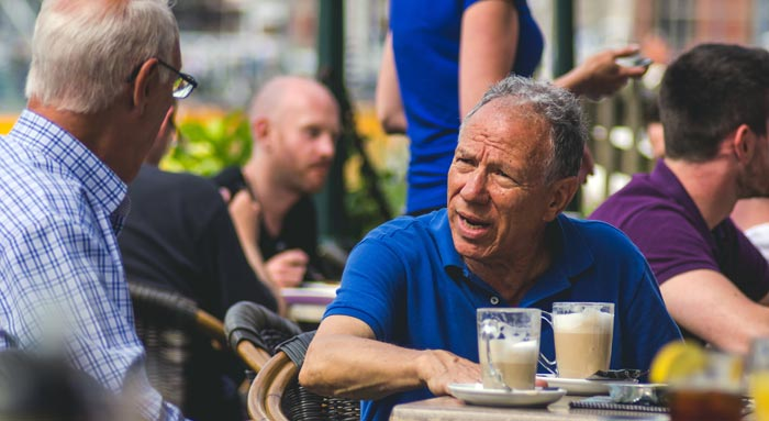 two men chatting at a coffee shop
